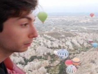 Alex Fullerton With Hot Air Balloons In The Background