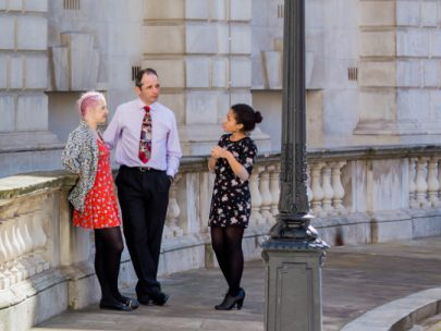 Three DCMS Team Members in Horse Guards' Road Courtyard