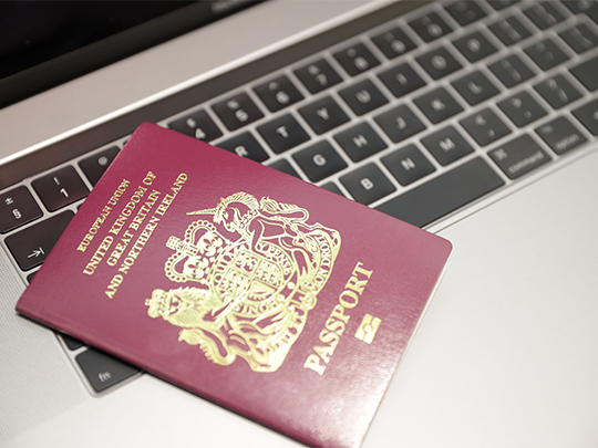 Passport On Laptop Keyboard