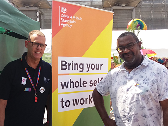 Two Dvsa Team Members At Stall