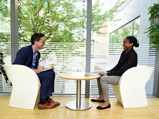 Two Employee Working Across Table