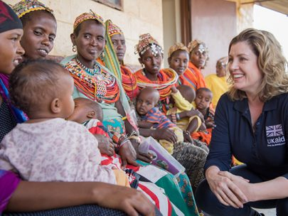 Uk Aid Worker Talking To Mothers And Children